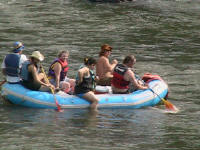 A group of rafters, none with helmets, one without even a PFD! - Lower Nolichucky, TN